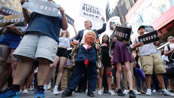 Protestors gather in Times Square, Wednesday, July 26, 2017, in New York. President Donald Trump declared a ban Wednesday on transgender troops serving anywhere in the U.S. military, catching the Pentagon flat-footed and unable to explain what it cal (The Associated Press)