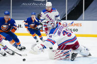 New York Rangers goaltender Igor Shesterkin (31) reaches for the puck during the second period of an NHL hockey game against the New York Islanders Sunday, April 11, 2021, in Uniondale, N.Y. (AP Photo/Frank Franklin II)