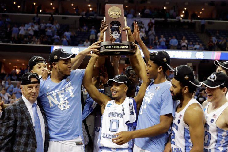 North Carolina players celebrate winning the South Region of the NCAA tournament. (Getty)