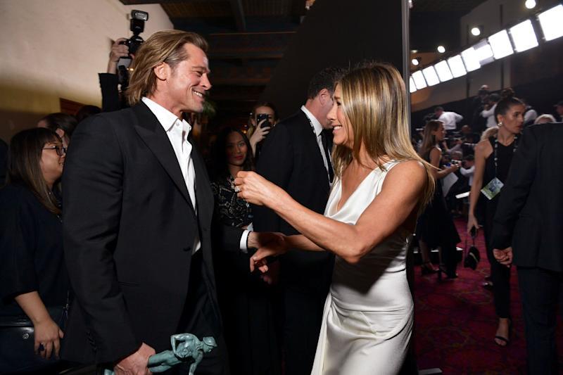 Brad Pitt and Jennifer Aniston greet each other at the Screen ActorsGuild Awards on Sunday. (Photo: Emma McIntyre via Getty Images for Turner)