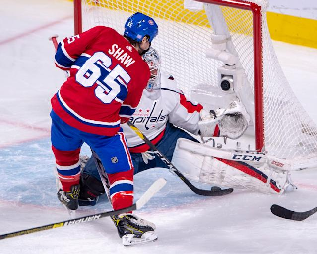 Montreal Canadiens right wing Andrew Shaw (65) is stopped by Washington Capitals goaltender Braden Holtby (70) during second period NHL hockey action Monday, Nov. 19, 2018 in Montreal. (Ryan Remiorz/The Canadian Press via AP)