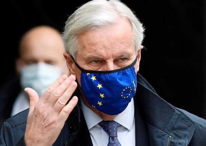 FILE PHOTO: The European Union's chief Brexit negotiator, Michel Barnier, wearing a face mask as he walks to Brexit trade negotiations in London