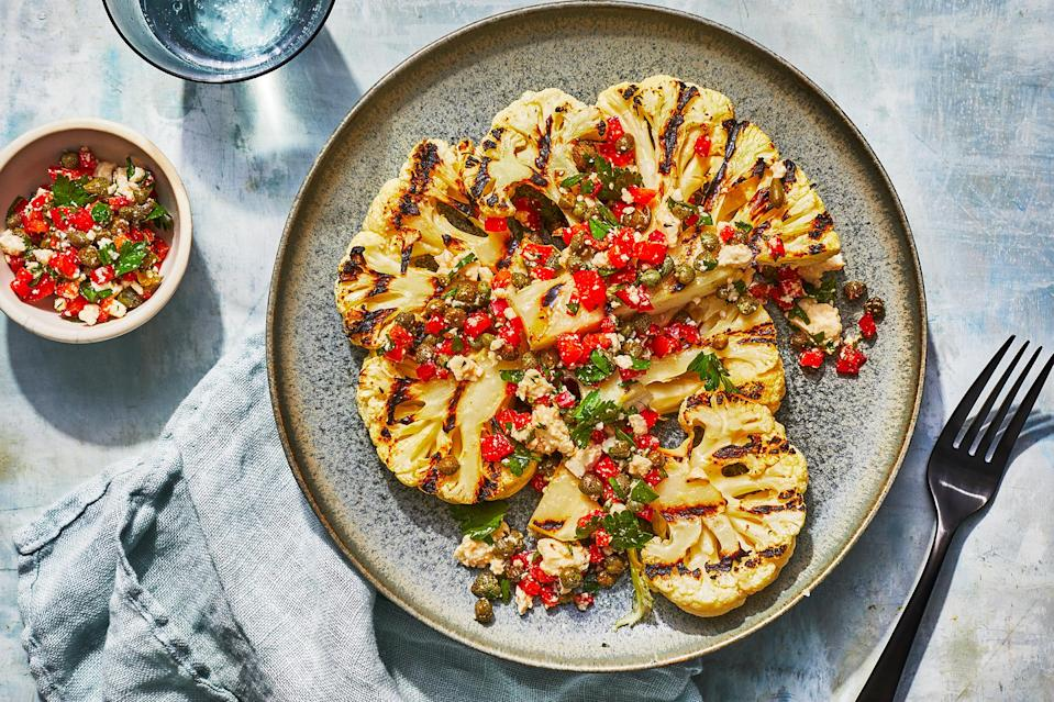 <p>The tiny bits of red bell pepper add a nice sweet crunch to these grilled cauliflower wedges with a feta cheese and olive oil drizzle. Keeping the core of the cauliflower intact helps the wedges stay sturdy while grilling.</p>