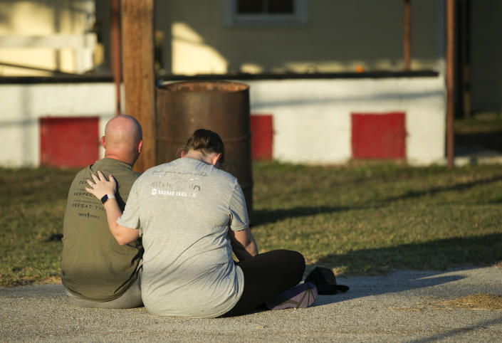 <p>A couple comfort each other at a community center in Sutherland Springs, Texas, near the scene of a mass shooting at the First Baptist Church, Nov. 5, 2017. (Jay Janner/Austin American-Statesman via AP) </p>