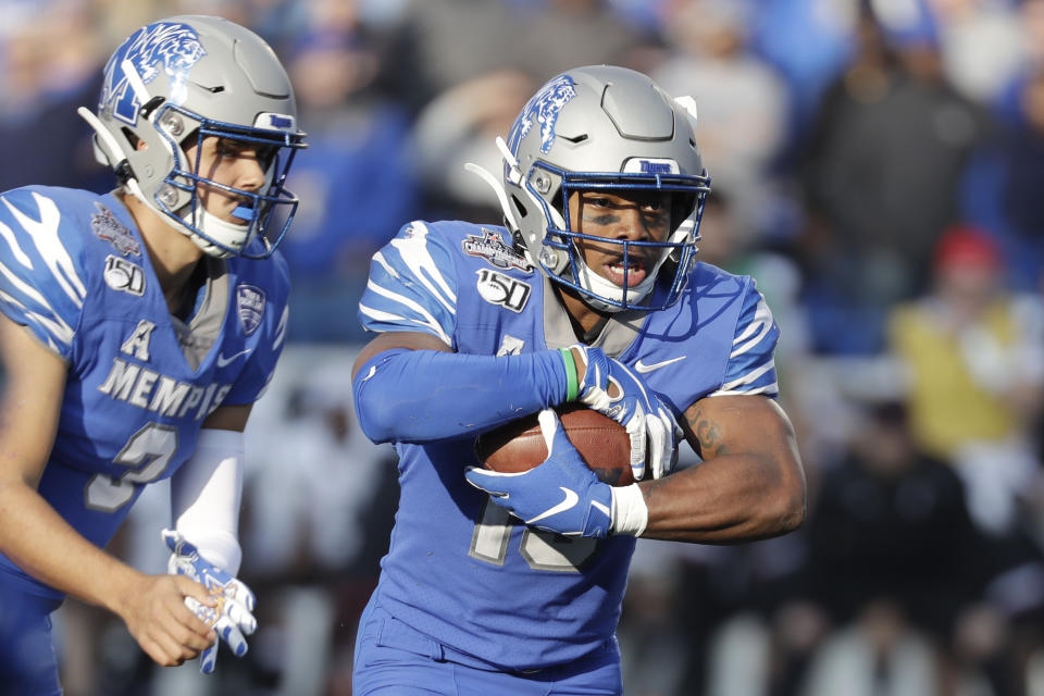 Memphis running back Kenneth Gainwell, right, carries the ball against Cincinnati during the first half of an NCAA college football game for the American Athletic Conference championship Saturday, Dec. 7, 2019, in Memphis, Tenn. (AP Photo/Mark Humphrey)