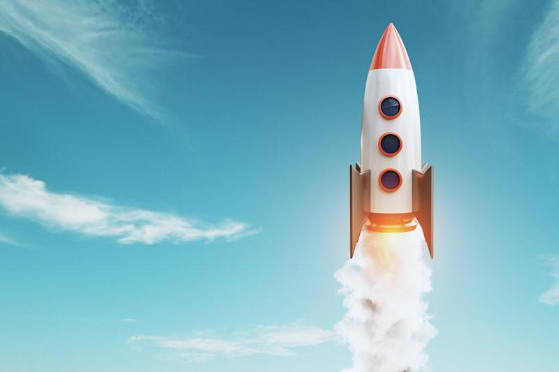 A rocket lifting off into the sky.