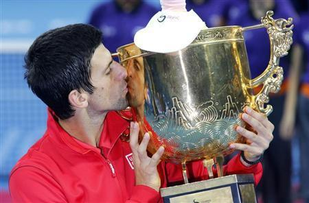 Novak Djokovic of Serbia kisses the trophy after winning his men's singles final match against Rafael Nadal of Spain at the China Open tennis tournament in Beijing October 6, 2013. REUTERS/Kim Kyung-Hoon