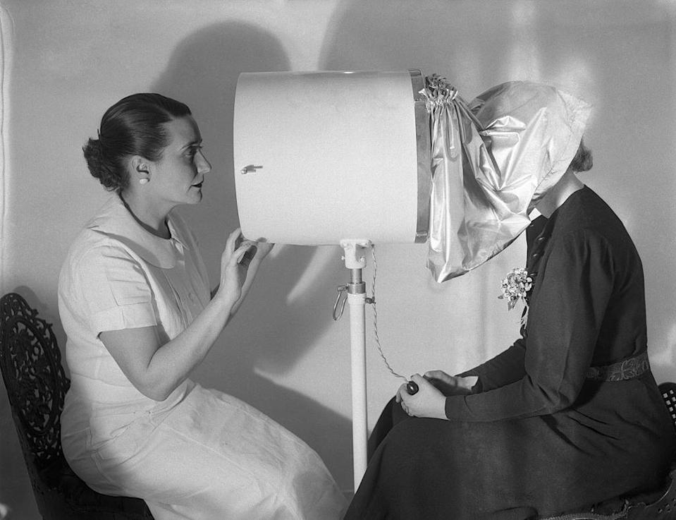 <p>In case you didn't really know what beauty treatments you were in need of, you could pop your head underneath this hood, and the device would magnify your imperfections. The beautician peaking in on the other side could then pinpoint the exact course of action. </p>