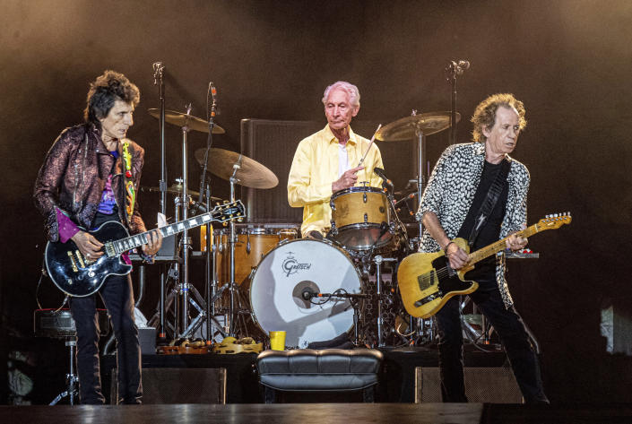 FILE - Ronnie Wood, from left, Charlie Watts and Keith Richards of The Rolling Stones perform on July 15, 2019, in New Orleans. Watts' publicist, Bernard Doherty, said Watts passed away peacefully in a London hospital surrounded by his family on Tuesday, Aug. 24, 2021. He was 80. (Photo by Amy Harris/Invision/AP, File)