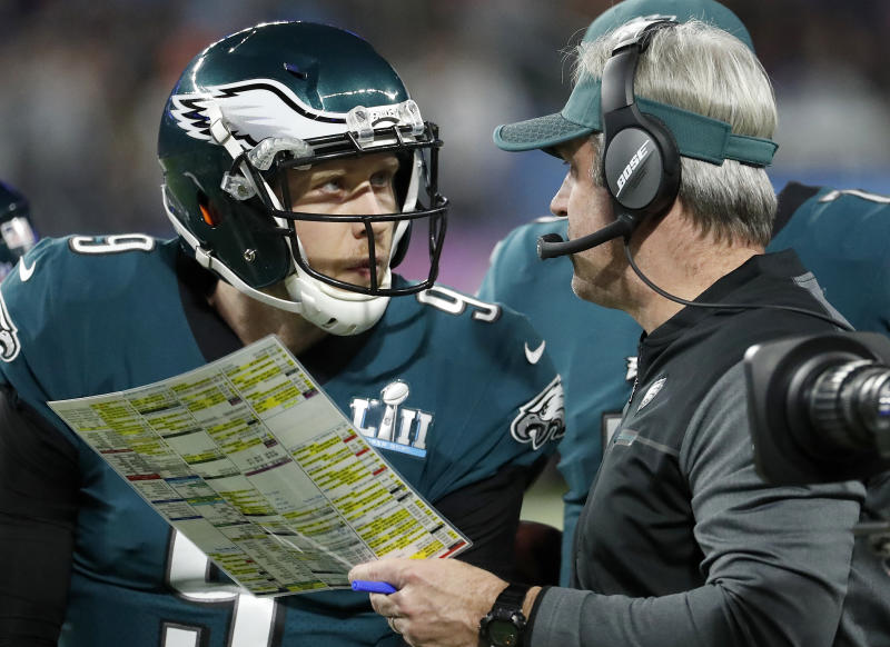 """FILE - In this Feb. 4, 2018, file photo, Philadelphia Eagles head coach Doug Pederson, right, talks to Nick Foles during the first half of the NFL Super Bowl 52 football game against the New England Patriots, in Minneapolis. Facing the mighty New England Patriots on the NFL's biggest stage, Philadelphia Eagles coach Doug Pederson's decision to try a trick play _ the """"Philly Special"""" _ on a fourth down late in the first half of Super Bowl 52 will be remembered as one of the gutsiest calls in sports history. That signature moment between Foles and Pederson standing on the sideline discussing the play was turned into a bronze statue that sits outside the team's stadium as a reminder of the greatest play in franchise history. (AP Photo/Matt York, File)"""