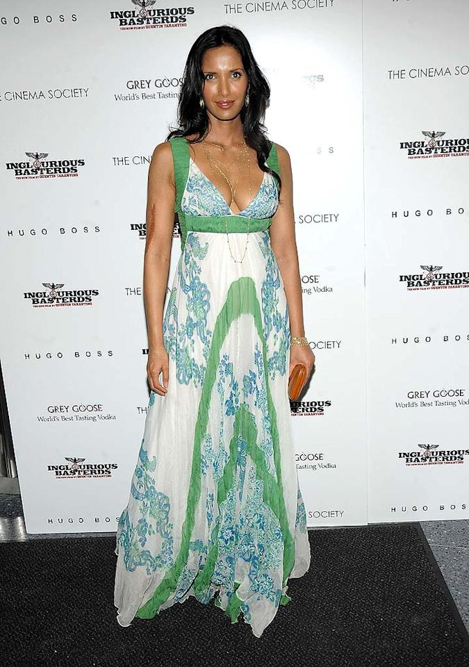 """Right behind Michelle was """"Top Chef"""" hostess with the mostest Padma Lakshmi in a casual yet chic Catherine Malandrino gown and gold accessories. Jamie McCarthy/<a href=""""http://www.wireimage.com"""" target=""""new"""">WireImage.com</a> - August 17, 2009"""