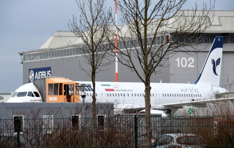 "An Airbus A321 with the Iranian flag and description ""The airline of the Islamic Republic of Iran"" is parked at the Airbus facility in Hamburg"