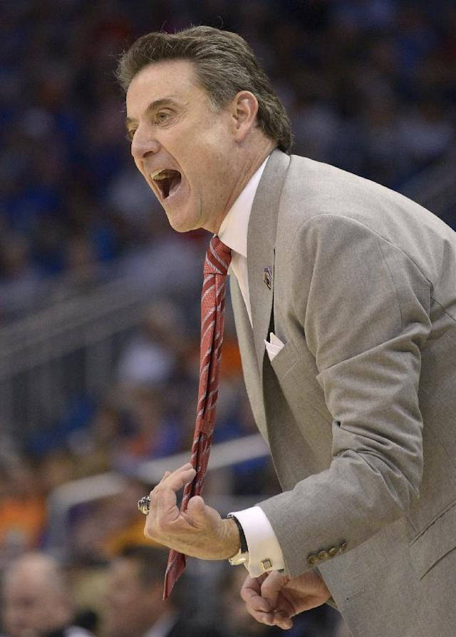 Louisville coach Rick Pitino yells at his team during the first half in a third-round game in the NCAA college basketball tournament against Saint Louis, Saturday, March 22, 2014, in Orlando, Fla. (AP Photo/Phelan M. Ebenhack)