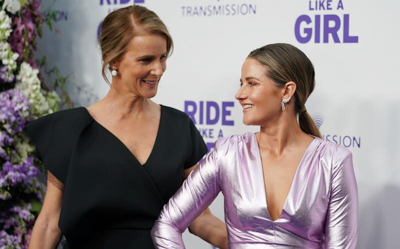 Rachel Griffiths and Michelle Payne arrive during the World Premiere of 'Ride Like A Girl' at Village Jam Factory in Melbourne, Sunday, September 8, 2019. Ride Like A Girl is the true story of Michelle Payne, the first female jockey to win the Melbourne Cup and the film is the directorial debut from Australian actor Rachel Griffiths. (AAP Image/Scott Barbour)