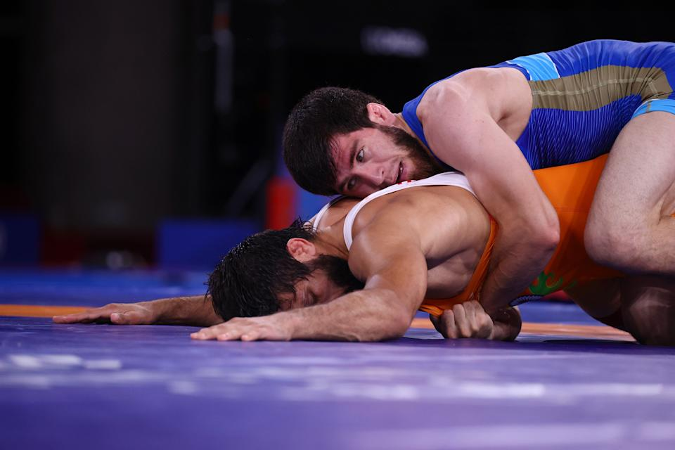 Tokyo 2020 Olympics - Wrestling - Freestyle - Men's 57kg - Gold medal match - Makuhari Messe Hall A, Chiba, Japan - August 5, 2021. Zavur Uguev of the Russian Olympic Committee in action against Ravi Kumar of India. REUTERS/Leah Millis