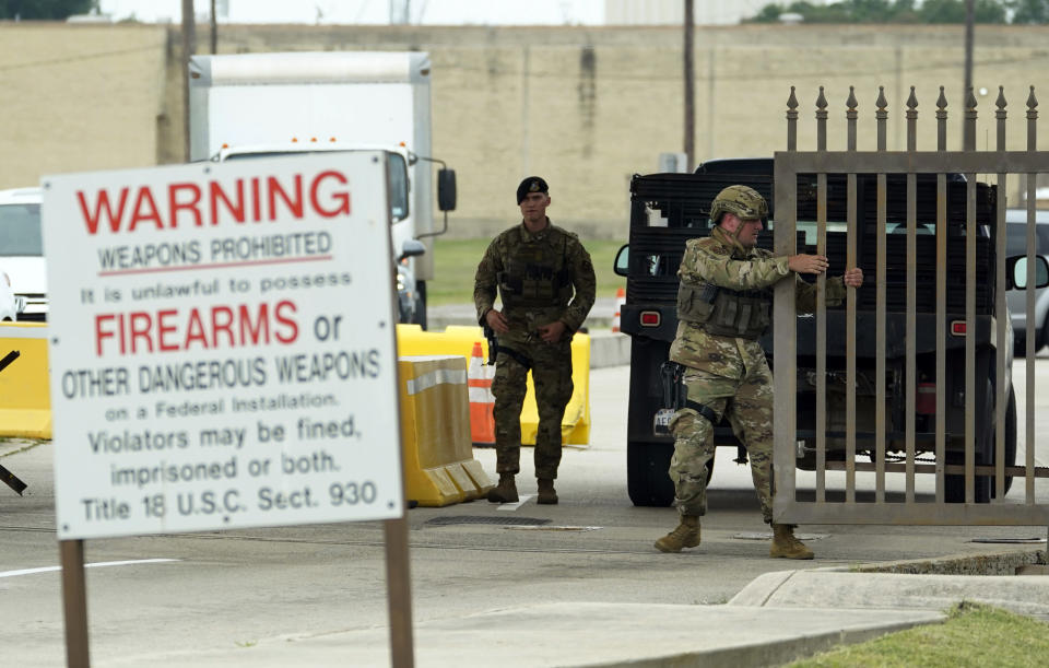 Military police close a gate at JBSA-Lackland Air Force Base gate, Wednesday, June 9, 2021, in San Antonio. The Air Force was put on lockdown as police and military officials say they searched for two people suspected of shooting into the base from outside. (AP Photo/Eric Gay)