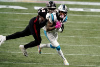 Carolina Panthers wide receiver Robby Anderson (11) is wraped up by Atlanta Falcons linebacker Foye Oluokun (54) during the first half of an NFL football game, Sunday, Oct. 11, 2020, in Atlanta. (AP Photo/Brynn Anderson)