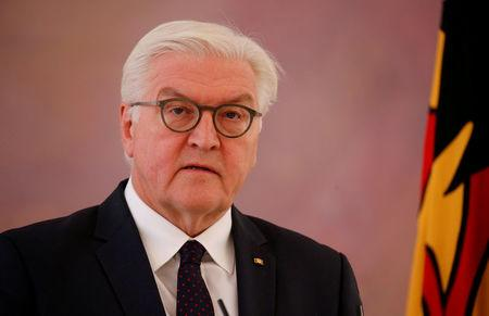FILE PHOTO - German President Frank-Walter Steinmeier gives a statement after a meeting with Chancellor Angela Merkel, as coalition government talks collapsed in Berlin, Germany, November 20, 2017. REUTERS/Axel Schmidt
