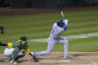 Kansas City Royals' Kelvin Gutierrez hits a two-run single in front of Oakland Athletics catcher Sean Murphy during the seventh inning of a baseball game in Oakland, Calif., Thursday, June 10, 2021. (AP Photo/Jeff Chiu)
