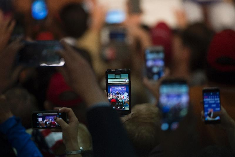 A network of social media supporters amplified the Trump message, not only reinforcing his vision but also actively seeking to counter anti-Trump forces (AFP Photo/Molly Riley)