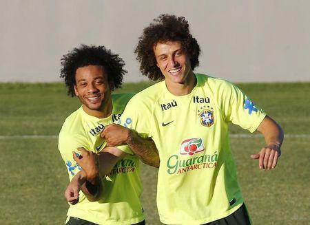 Brazil's national soccer team players Marcelo (L) and David Luiz (R) attend a training session at Estadio Presidente Vargas stadium in Fortaleza July 3, 2014. REUTERS/Yves Herman