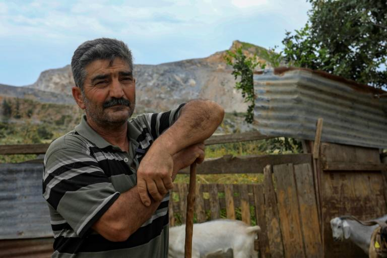 Herder Jamal says he will have to leave the mountain in northern Cyprus -- where his goats have grazed for years -- due to quarrying (AFP Photo/Emily IRVING-SWIFT)