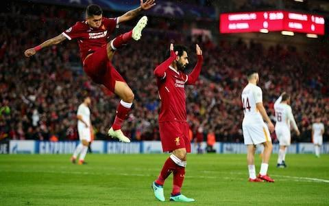 "Jurgen Klopp acclaimed the 'genius' of Mohamed Salah as Liverpool took a major step towards the Champions League final, but warned Roma have already proved their reputation as comeback masters. Liverpool seemed to be heading to Kiev when leading 5-0 after 81 minutes of a pulsating first leg at Anfield, Salah scoring two and creating two of the five goals. But two late strikes from Edin Dzeko and Diego Perotti revived the Italians' hopes, with their manager Eusebio Di Francesco claiming his team needed 'belief rather than a miracle' in next week's return game at Stadio Olimpico. Roma overturned the same three-goal deficit to knock out Barcelona in the quarter-final. Klopp said he felt flat after the final whistle, not because of the performance or late lapses but due to a serious knee injury to Alex Oxlade-Chamberlain which appears to have ended his season and probably his World Cup hopes. liverpool roma grid There was the usual appreciation for Salah's extraordinary skills, however. ""In that shape he is outstanding,"" said Klopp. ""The way we played the first 15 minutes we had to adapt a bit, and then we played how we played and he has a massive impact on that. ""The first goal is a genius strike. He has scored a few like this. It is no coincidence. In the second goal he is cool in the moment and then makes the other two goals. ""What a player. If you think he is the best in the world, write it or say it. What I will say is he is in outstandingly, world-class shape. To be the best in the world you have to do it for a longer period, I think. The other two (Messi and Ronaldo) are not bad. Salah chose not to celebrate his goals against former club Roma Credit: GETTY IMAGES ""If anyone wants to say it was my mistake we conceded two goal because I changed the striker I have no problem with that."" Italian reporters asked Klopp whether the result would have been reversed if Salah was still a Roma player. ""If, if, if,"" he said. ""If Neymar does not go to PSG we would still have Philippe Coutinho. ""We hoped Mo would have that impact. He is playing a season which is not normal. We try to help him. It is a team game but you need the players to make the decisive things and he is very good at making decisive things, so we are very glad that we could get him."" Liverpool vs Roma player ratings Oxlade-Chamberlain's injury on 15 minutes soured the occasion, Klopp fearing the worst. ""The medical department is concerned without a scan. It does not look good,"" said Klopp. ""I hope it only feels bad. We will see. I am not flying mood wise. We lost a fantastic player and that is not good news so I am not in the mood to talk about about fantastic things. We will go there and play as well as we can. It seems Liverpool always has to take the more difficult way. ""Now we have to work again in Rome, that is no problem. We would have had to work if we won 5-0. Roma would have tried everything anyway. Roma need to score goals against us and as I said a few times, we are not Barcelona. Barcelona is one of the two or three best teams in the world and they won so many things in the last few years and we didn't, so we will fight with all we have for that result. It is a much better result than we expected."" Roma v Liverpool Di Francesco said if any of his players did not believe they could complete another comeback, he would not select them. Klopp responded: ""If one of my players does not think Roma can come back, he will not play. Although I do not have many players to choose. ""The atmosphere tonight was absolutely outstanding. I say to everyone with a ticket we need the same at 12.30pm [on Saturday] against Stoke."" Liverpool v Roma - Champions League semi-final 1st leg"