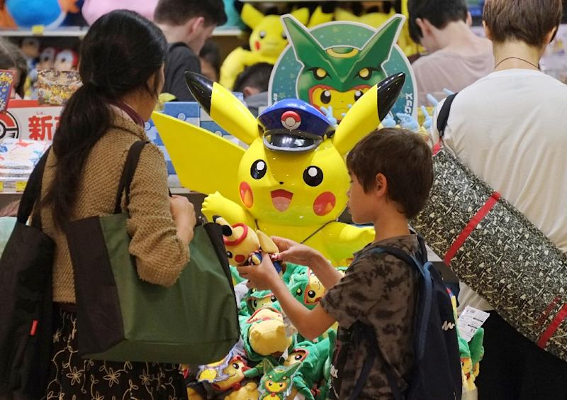 Nintendo, the Pokemon franchise creator, surged nearly 11% to end the morning at 30,780 yen ($290), up more than 100% from its July 6 close (AFP Photo/Kazuhiro Nogi)