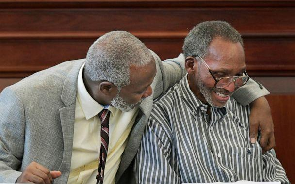 PHOTO: Nathan Myers, left, hugs his uncle, Clifford Williams, during a news conference after their 1976 murder convictions were overturned Thursday, March 28, 2019 in Jacksonville, Fla. (Will Dickey/The Florida Times-Union via AP, FILE)