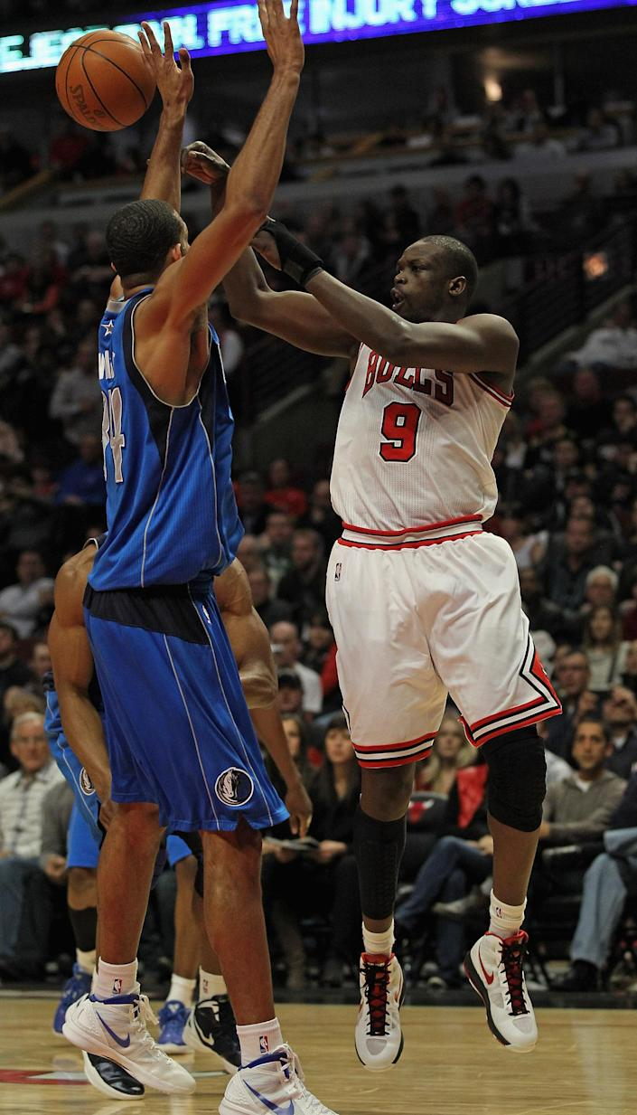 CHICAGO, IL - APRIL 21: Loul Deng #9 of the Chicago Bulls passes over Brandon Wright #34 of the Dallas Mavericks at the United Center on April 21, 2012 in Chicago, Illinois. The Bulls defeated the Mavericks 93-83. NOTE TO USER: User expressly acknowledges and agress that, by downloading and/or using this photograph, User is consenting to the terms and conditions of the Getty Images License Agreement. (Photo by Jonathan Daniel/Getty Images)