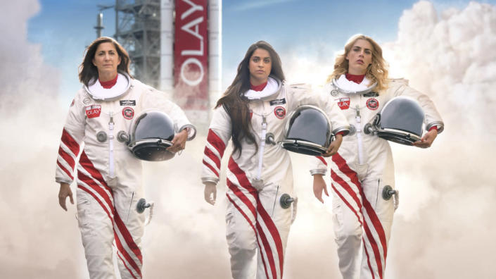 This undated image provided by Olay shows from left, retired astronaut Nicole Stott, Lilly Singh and Busy Philipps in a scene from the company's 2020 Super Bowl NFL football spot. (Olay via AP)