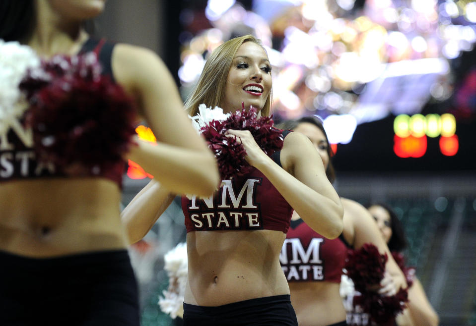 New Mexico State cheerleaders perform during the first half of an NCAA college men's basketball game against Cal State Bakersfield in the semifinals of the West Athletic Conference tournament Friday, March 14, 2014, in Las Vegas. New Mexico State won 69-63. (AP Photo/David Becker)