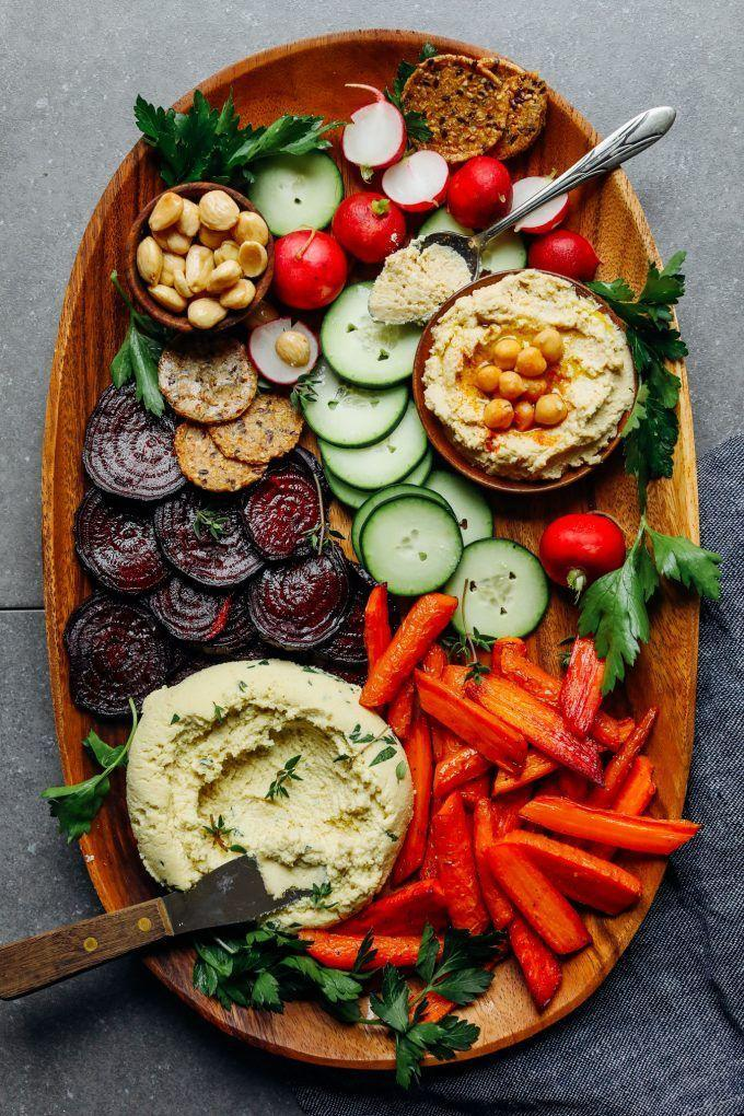 """<p><br>Feeling fancy? This cheese and crudité spread puts meat-filled charcuterie to shame.</p><p><a class=""""link rapid-noclick-resp"""" href=""""https://www.womenshealthmag.com/food/g31259691/vegan-bbq-recipes/?slide=10"""" rel=""""nofollow noopener"""" target=""""_blank"""" data-ylk=""""slk:GET THE RECIPE"""">GET THE RECIPE</a><br></p><p><em>Per serving: 251 calories, 22 g fat (4 g saturated), 15 g carbs, 8 g sugar, 167 mg sodium, 5 g fiber, 4 g protein</em></p>"""