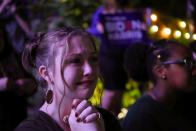 Camille Christian cries as she watches Democratic vice presidential nominee Kamala Harris' speech after media announced she and presidential nominee Joe Biden won the 2020 U.S. presidential election, at Axelrad Beer Garden in Houston, Texas