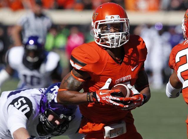 Oklahoma State's Josh Stewart (5) returns a punt for a touchdown in front of TCU defender James Power (50) in the first quarter of an NCAA college football game in Stillwater, Okla., Saturday, Oct. 19, 2013. (AP Photo/Sue Ogrocki)
