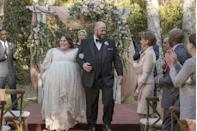 <p>After watching Kate Pearson grow up on <em>This Is Us</em>, viewers finally got to witness her wedding to Toby in season 2. The bride wore a beaded lace empire waist gown with a sweetheart neckline and three-quarter length sleeves.</p>