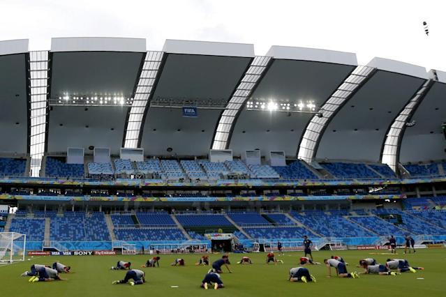 United States national soccer players stretch during an official training session the day before the group G World Cup soccer match between Ghana and the United States at the Arena das Dunas in Natal, Brazil, Sunday, June 15, 2014. (AP Photo/Julio Cortez)