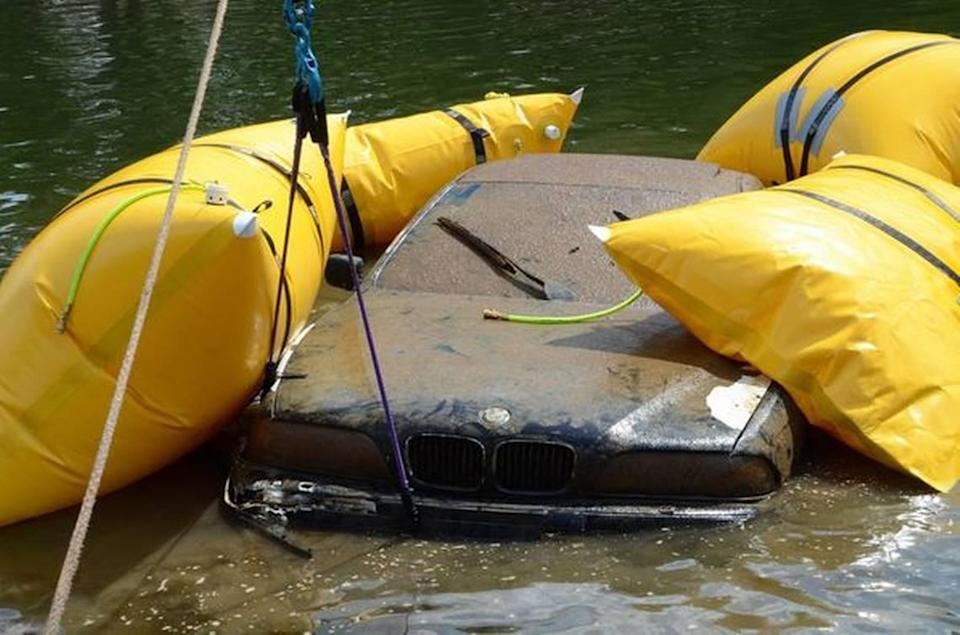 Special air bags lift the BMW to the surface of Lake Wylie on Wednesday, Sept. 15, 2021.