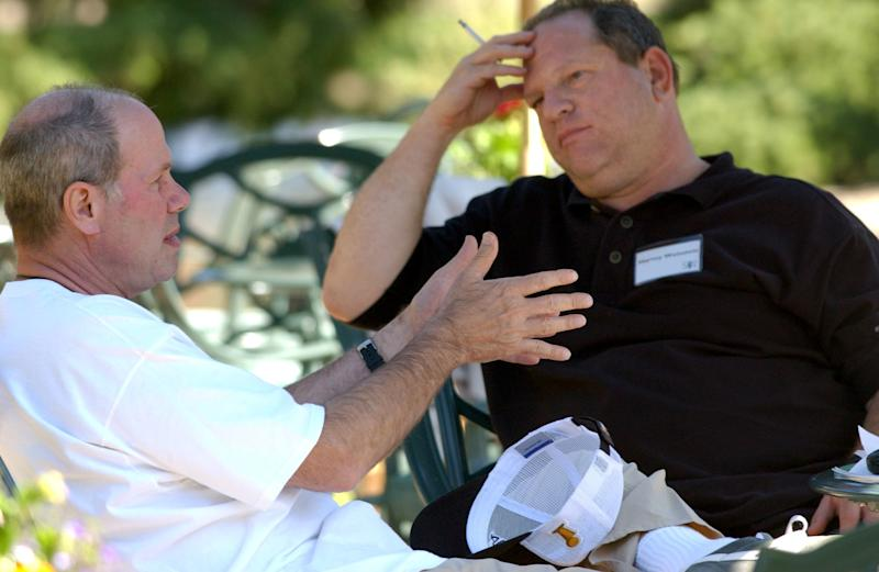 Michael Eisner, then CEO of the Walt Disney Company, talks with Harvey Weinstein back in 2004. (Bloomberg via Getty Images)