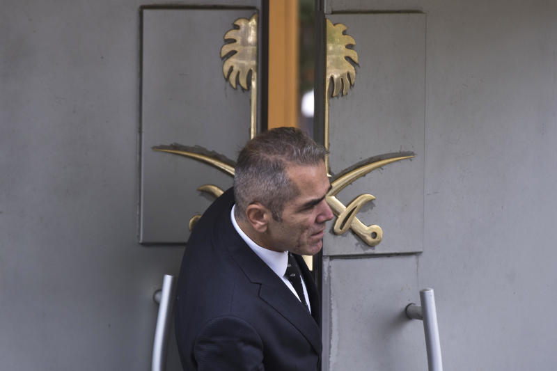 "A security guard looks out of the entrance of Saudi Arabia's consulate in Istanbul, Friday, Oct. 12, 2018. A senior Turkish official says Turkey and Saudi Arabia will form a ""joint working group"" to look into the disappearance of Saudi writer Jamal Khashoggi who vanished last week after entering the Saudi diplomatic mission in Istanbul. (AP Photo/Petros Giannakouris)"