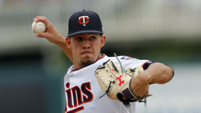 FILE - In this Monday, March 18, 2019, file photo, Minnesota Twins starting pitcher Jose Berrios works against the Boston Red Sox in the first inning of a spring training baseball game in Fort Myers, Fla. The Twins are starting fresh with the youngest manager in the major leagues, a remade infield and a new closer. Starting fresh doesn't have to mean starting over, though, and the Twins have designs on contending for the division title. (AP Photo/John Bazemore, File)
