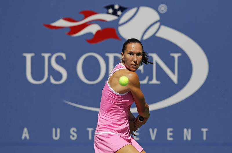 Serbia's Jelena Jankovic returns a shot to Spain's Lara Arruabarrena-Vecino in the second round of play at the 2012 US Open tennis tournament, Thursday, Aug. 30, 2012, in New York. (AP Photo/Kathy Willens)
