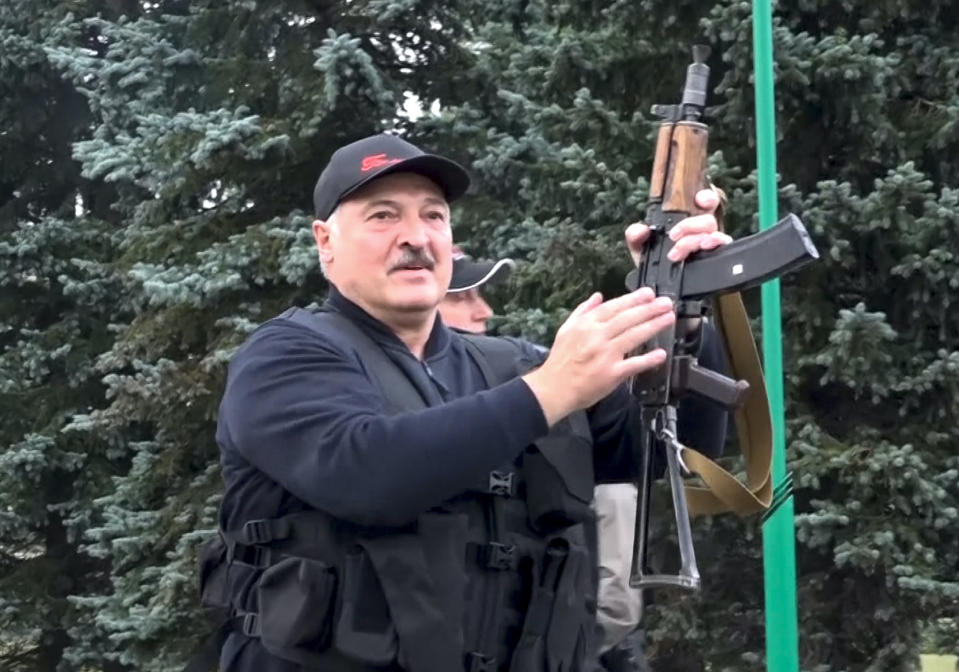 FILE - This Aug. 23, 2020, file image made from video provided by the State TV and Radio Company of Belarus shows Belarus President Alexander Lukashenko armed with a Kalashnikov-type rifle near the Palace of Independence in Minsk, Belarus. When Lukashenko became president in 1994, Belarus was an obscure country that had not even existed for three years. Over the next quarter-century, he brought it to the world's notice via dramatic repression, erratic behavior and colorful threats. (State TV and Radio Company of Belarus via AP, File)