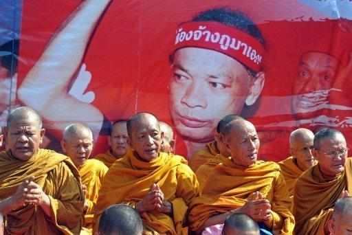"""Buddhist monks chant during a demonstration held by """"Red Shirt"""" supporters in Bangkok on Saturday to mark the second anniversary of a deadly crackdown on street protests"""