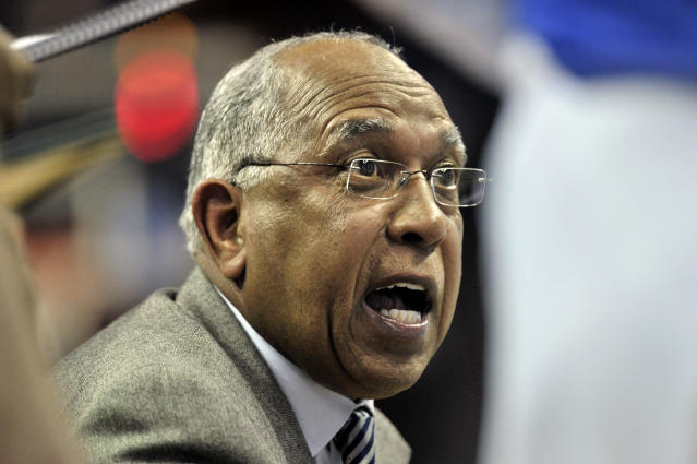 Memphis coach Tubby Smith talks to players during a timeout in the first half of an NCAA college basketball game against Wichita State on Tuesday, Feb. 6, 2018, in Memphis, Tenn. (AP Photo/Brandon Dill)