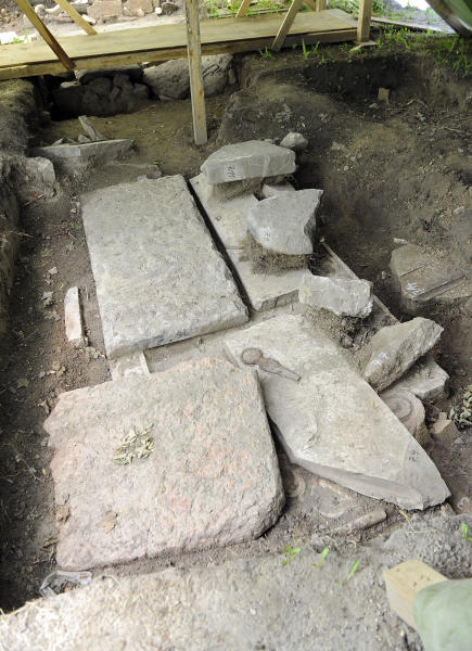 """Tombstones discovered at a small Jewish Cemetery in Vienna, Austria photographed Wednesday July 10, 2013. Vienna's Jewish community says a historically important trove of hundreds of ancient Jewish tombstones have been recently unearthed, including some dating back to the 16th century. Senior Jewish community official Raimund Fastenbauer said Wednesday that the headstones have """"high historical value."""" He says the gravestones were buried by the few Jews remaining in Vienna in 1943 to hide them from the Nazis and were recently found during renovation of the small cemetery where they originally stood. Vienna city officials they expect excavations to yield up to 800 headstones. (AP Photo/Hans Punz)"""