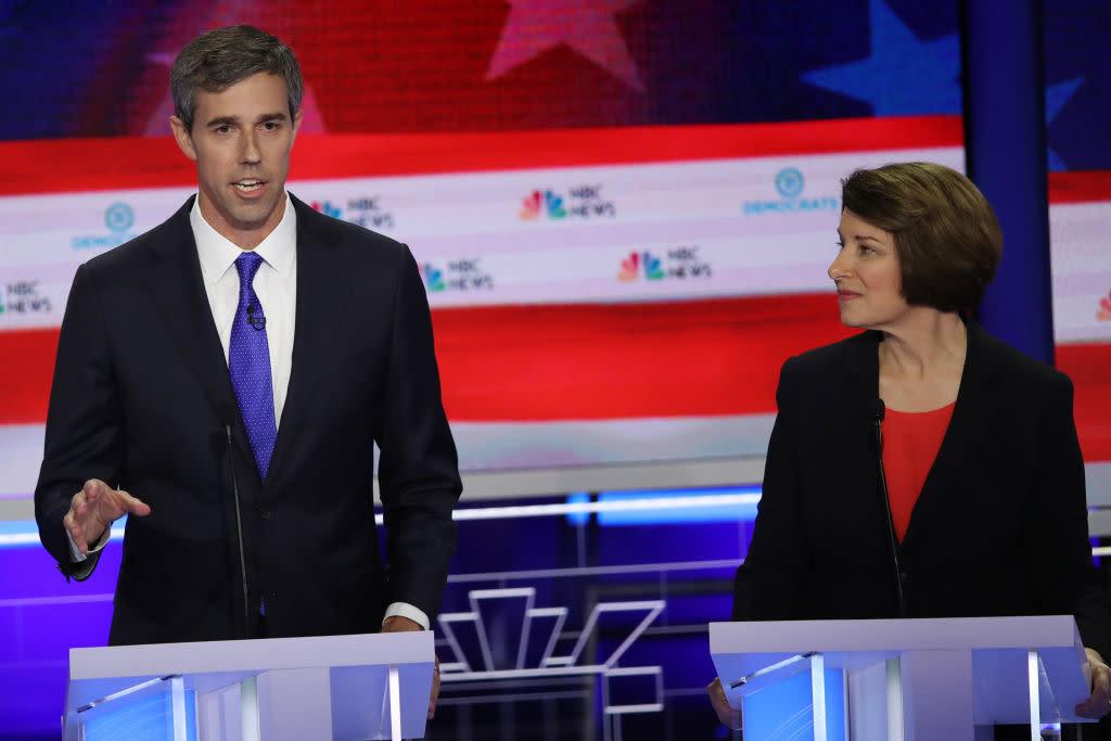 former Texas congressman Beto O'Rourke speaks as Minnesota Sen. Amy Klobuchar looks on during the first night of the Democratic presidential debate on June 26, 2019. | Joe Raedle—Getty Images