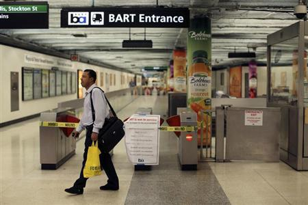 A man turns away at the Powell Street station after learning of a strike by employees of the Bay Area Rapid Transit (BART) in San Francisco
