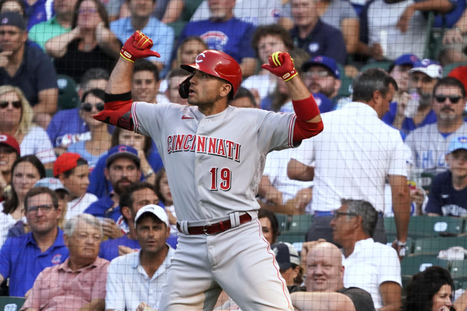 Cincinnati Reds' Joey Votto (19) gestures as he goes back to the dugout after hitting a home run against the Chicago Cubs during the first inning of a baseball game Tuesday, July 27, 2021, in Chicago. (AP Photo/David Banks)
