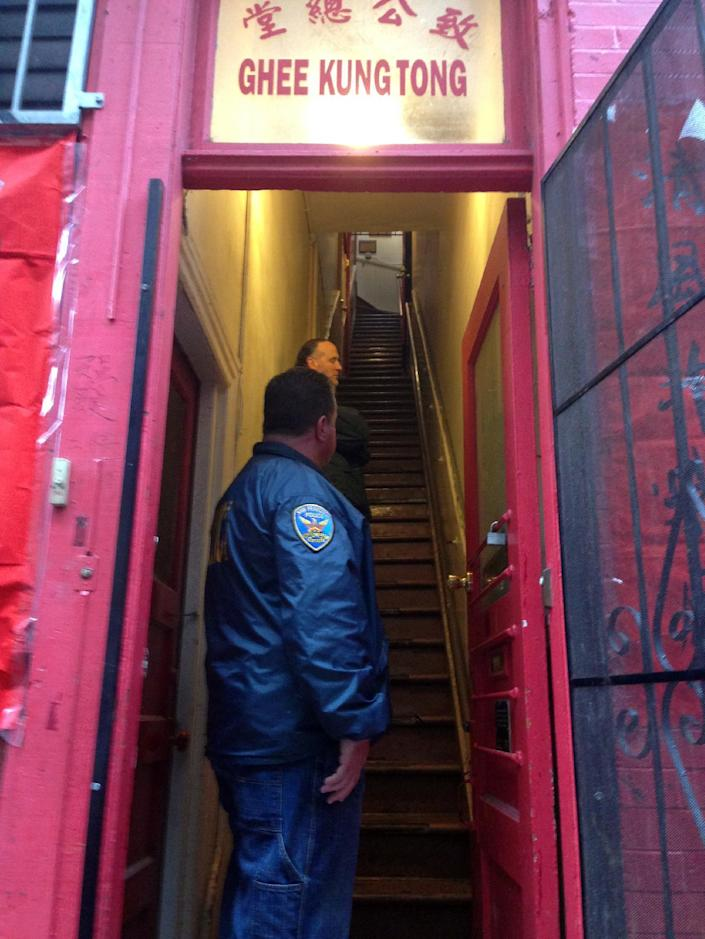 Police officers enter a business connected to California State Sen. Leland Yee in San Francisco, Wednesday, March 26, 2014. The FBI said Yee was arrested during a series of raids in the San Francisco Bay Area on Wednesday. (AP Photo/Jason Dearen)